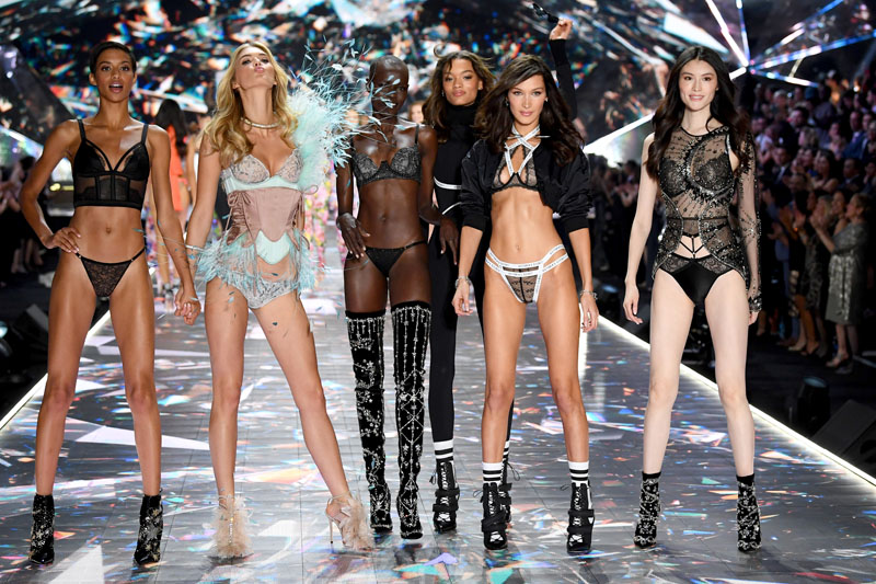 NEW YORK, NY - NOVEMBER 08:  (L-R) Jourdana Phillips, Grace Bol, Megan Williams, Lameka Fox, Bella Hadid, and Sui He walk the runway during the 2018 Victoria's Secret Fashion Show at Pier 94 on November 8, 2018 in New York City.  (Photo by Dimitrios Kambouris/Getty Images for Victoria's Secret)