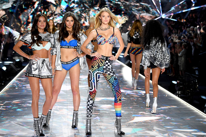 NEW YORK, NY - NOVEMBER 08:  Kelsey Merritt, Maia Cotton, and Willow Hand walk the runway during the 2018 Victoria's Secret Fashion Show at Pier 94 on November 8, 2018 in New York City.  (Photo by Dimitrios Kambouris/Getty Images for Victoria's Secret)