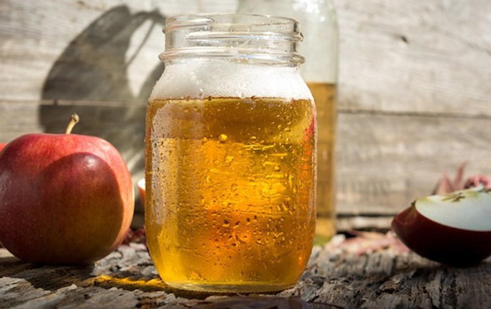 cider in a glass with apples