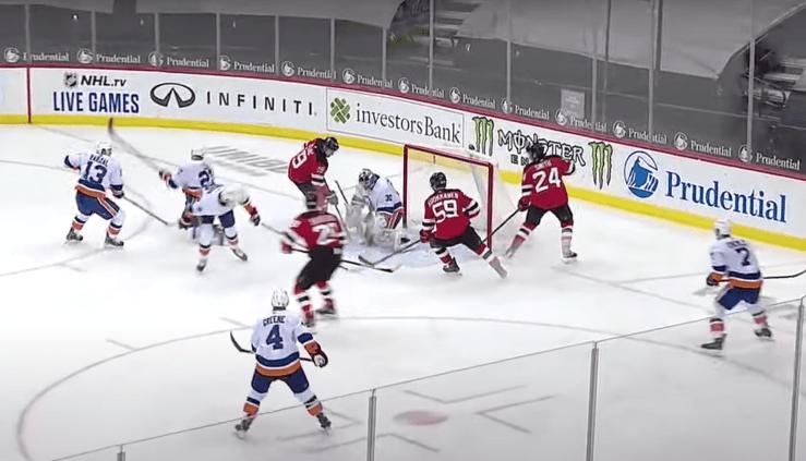Ilya Sorokin makes a save on the New Jersey Devils
