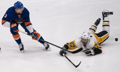 New York Islanders Adam Pelech against Sidney Crosby