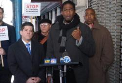 Councilmember Jumaane D. Williams, with Councilmember Vincent Gentile (l) and Brooklyn Borough President Eric Adams (r), announces new legislation to combat illegal home conversion. Image credit: Ernest Skinner/NYC Council