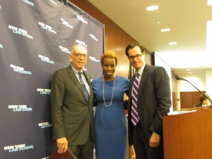 NYCHA Chair & CEO Shola Olatoye standing with NYLS Professor & the Center for New York City Law Director Ross Sandler (left) and NYLS President and Dean Anthony Crowell (right). Image credit: CityLand