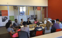 YES Program participants meet with St. John's student for lunch and discussion. (Photo Credit – Luis Aucapina)