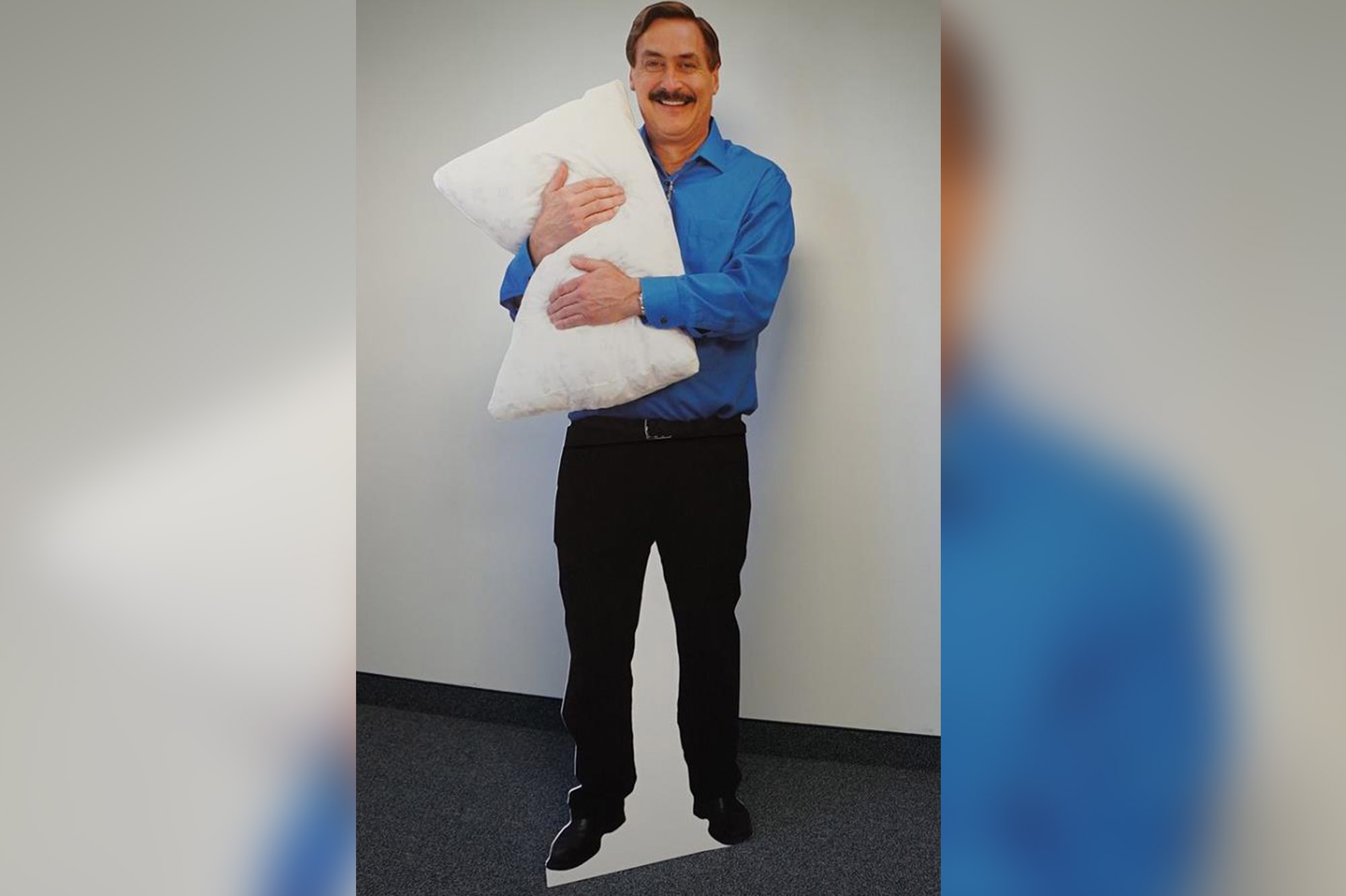 man hugging pillow in the cold was a