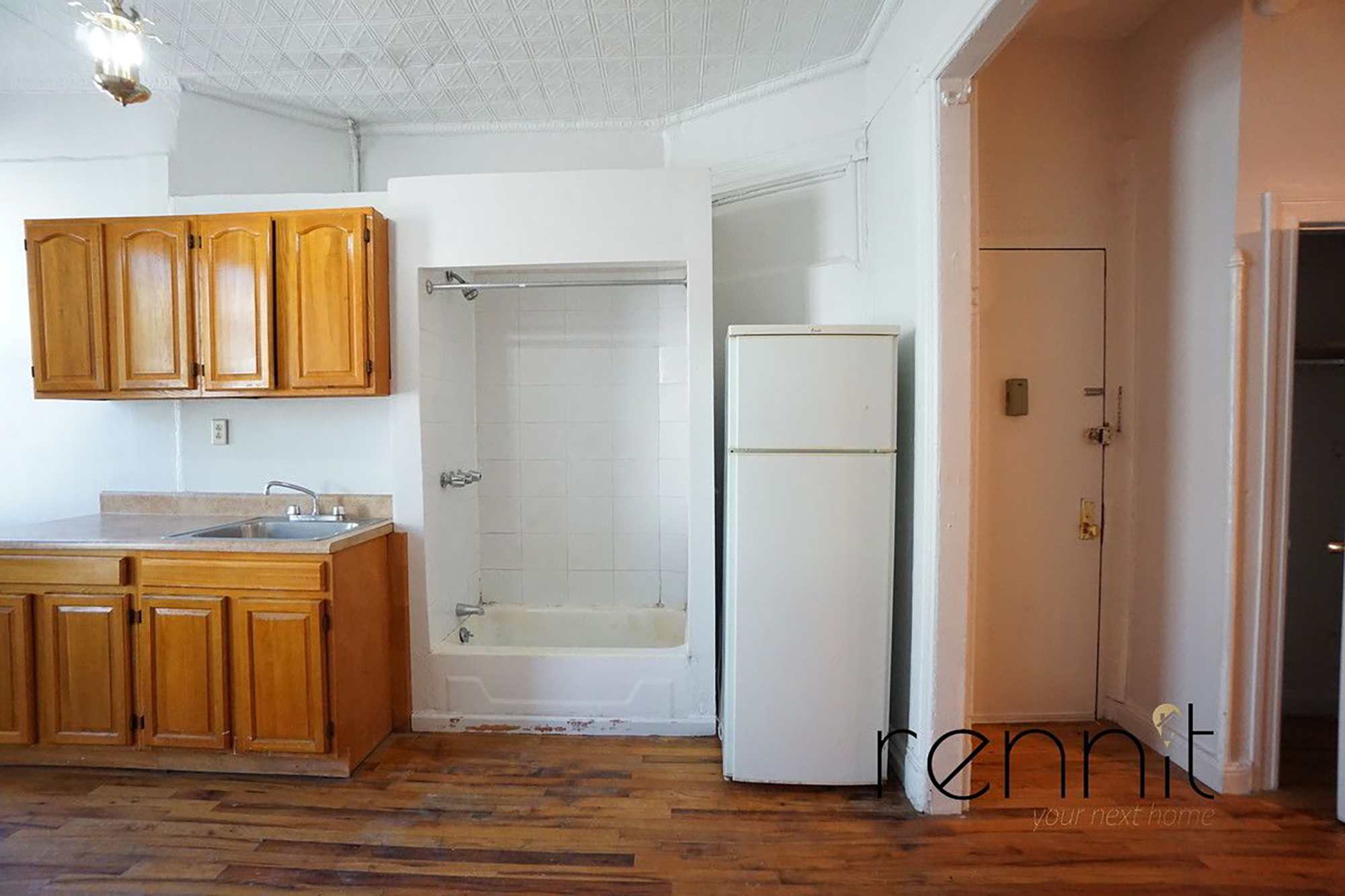 NYC apartment with shower in kitchen rents for $1,650 a month