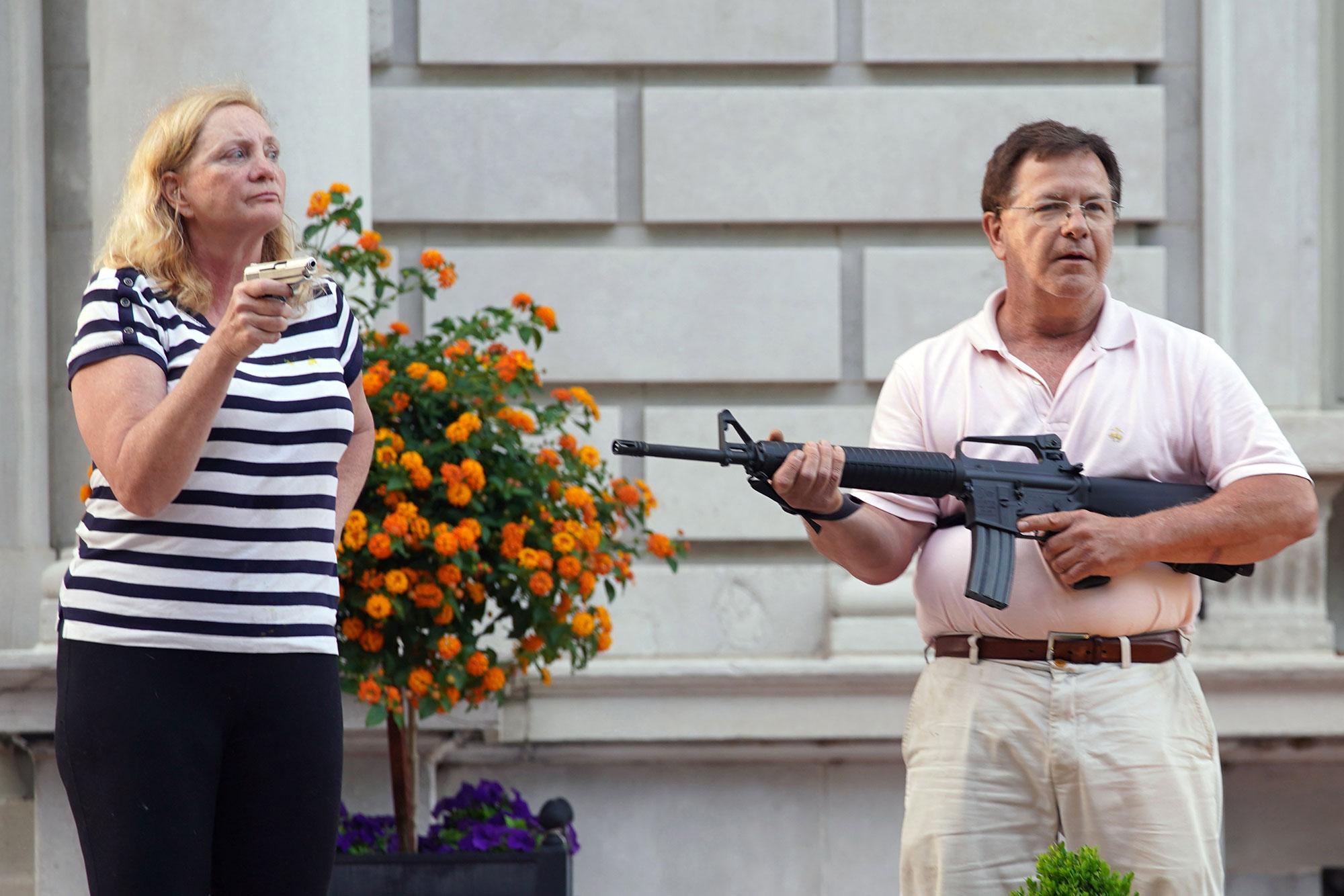 Mark and Patricia McCloskey's guns seized.