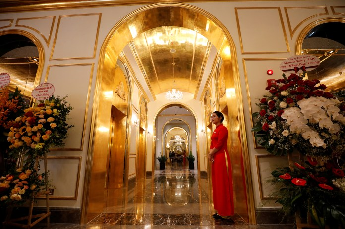 An employee in traditional dress is seen in the newly-inaugurated Dolce Hanoi Golden Lake luxury hotel, after the government eased a nationwide lockdown following the global outbreak of the coronavirus disease (COVID-19), in Hanoi
