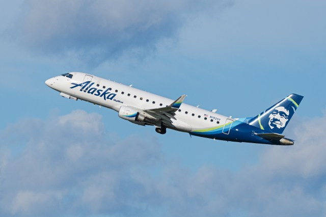An Alaska Airlines Embraer 175LR jet is airborne after take-off from Vancouver International Airport.