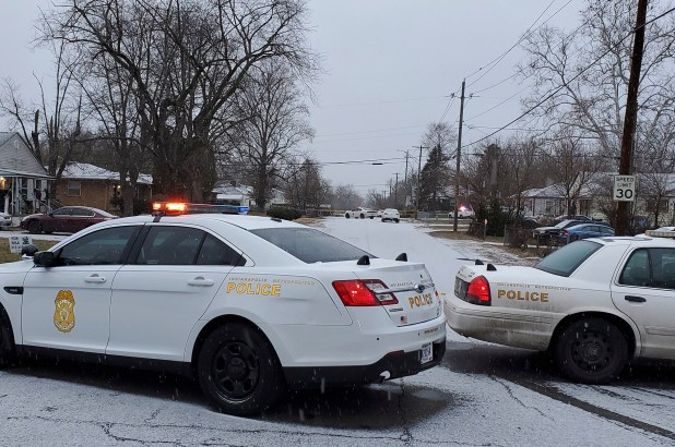 Indianapolis Metropolitan Police Department work the scene Sunday, Jan. 24, 2021 in Indianapolis where five people, including a pregnant woman, were shot to death