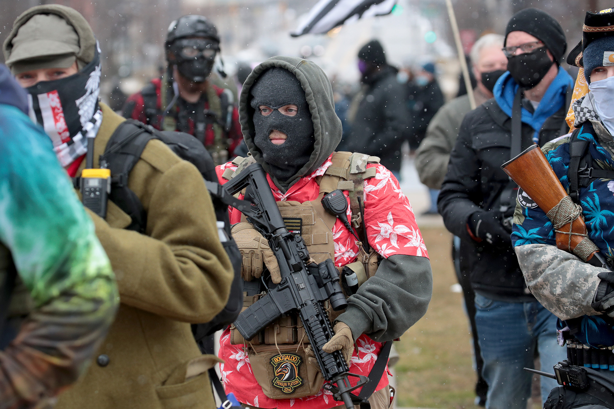 Armed protesters gather at Michigan state capitol