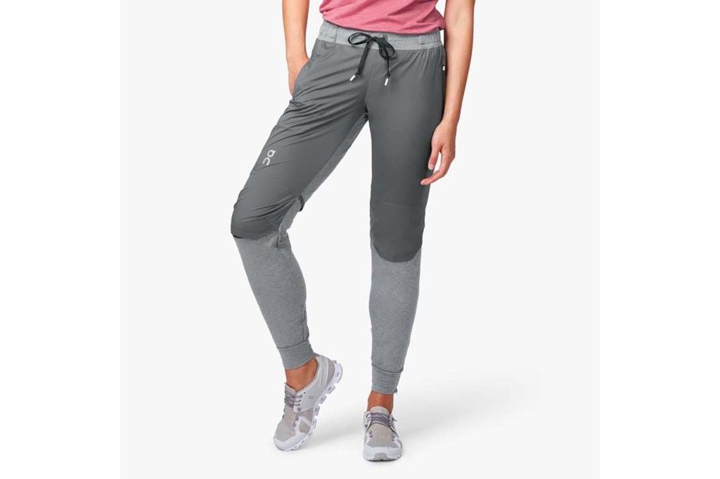 A woman in gray two-tones running pants
