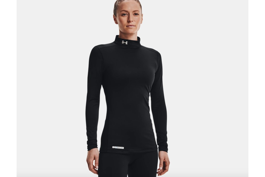 A woman in a black long sleeve running shirt with a high neck