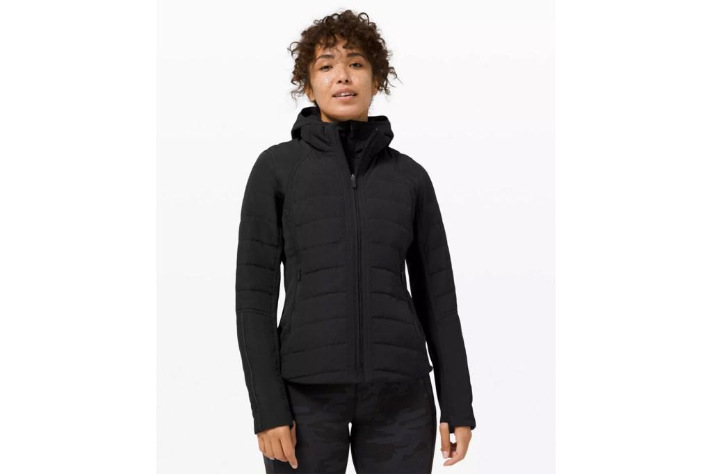A woman in a black puffer coat