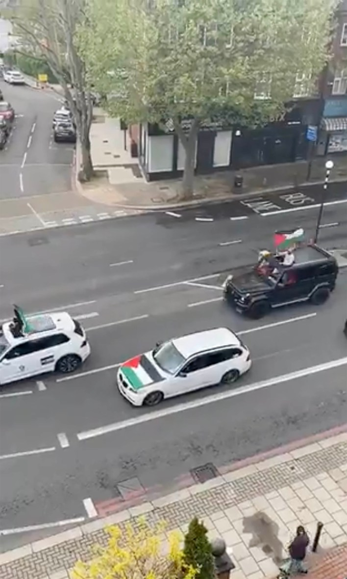 Cars decorated with Palestinian flags driving around London.