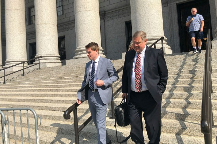 """John Lambert (left) posed as an attorney using the alias """"Eric Pope,"""" and duped at least six people and corporations, according to prosecutors."""