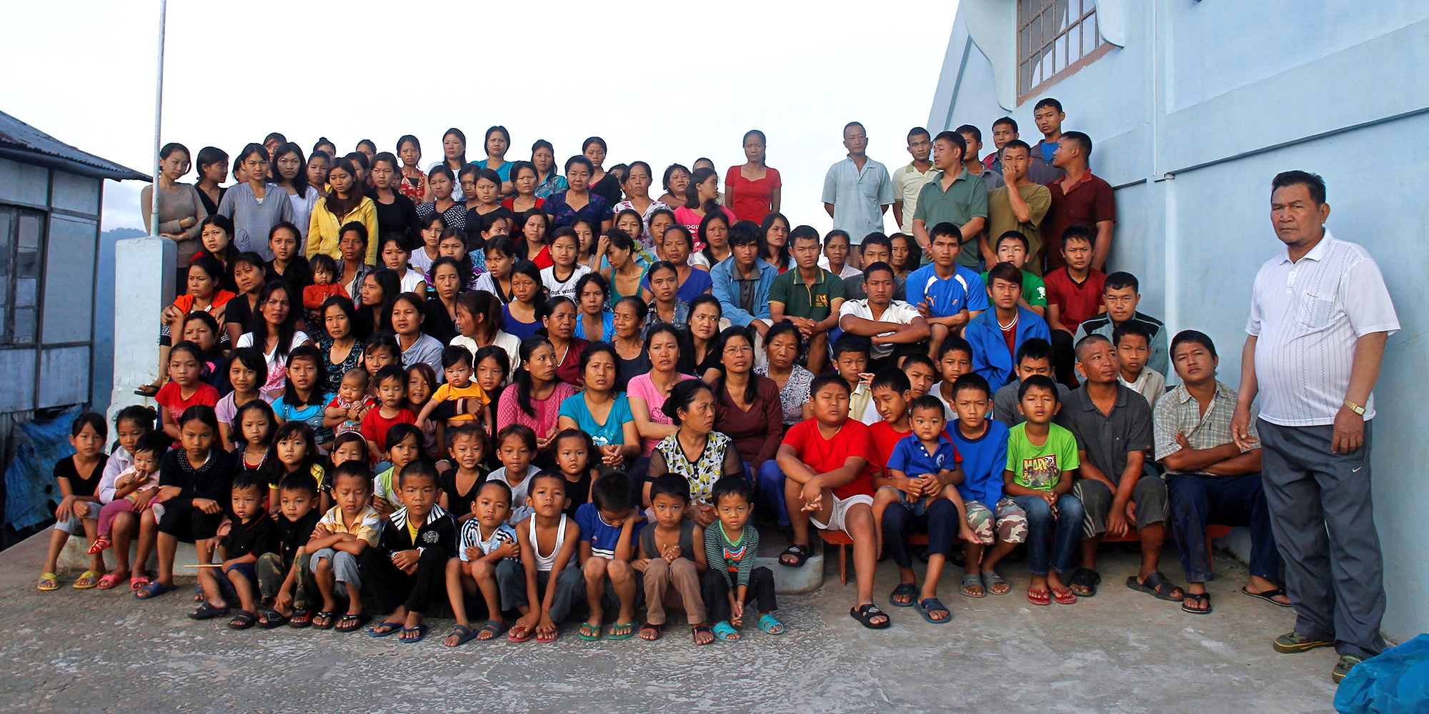 FILE PHOTO: Family members of Ziona poses for group photograph outside their residence in village Baktawng