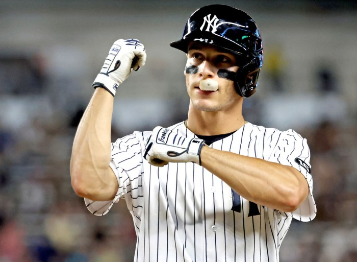 Andrew Velazquez celebrates after belting a single in the fourth inning of the Yankees' 7-5 win over the Twins.