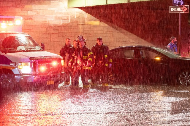 Firefighters respond to a scene where a car is stranded in Brooklyn ahead of Hurricane Henri on August 21, 2021.