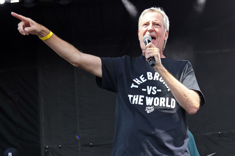 """New York Mayor Bill de Blasio speaks below """"It's time for hip hop in NYC: Bronx at Orchard Beach on August 16, 2021 in the Bronx, New York."""