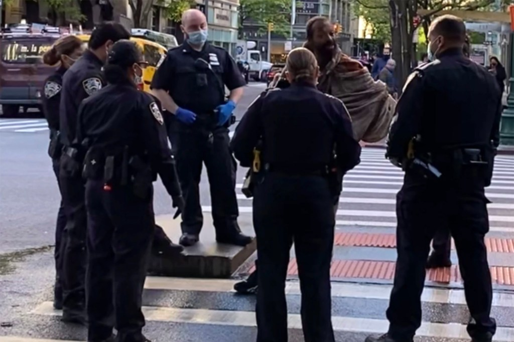 NYPD officers arrest Osvaldo Rosa after he assaulted Josh Epstein at West 66th Street and Columbus Avenue on May 8, 2021.