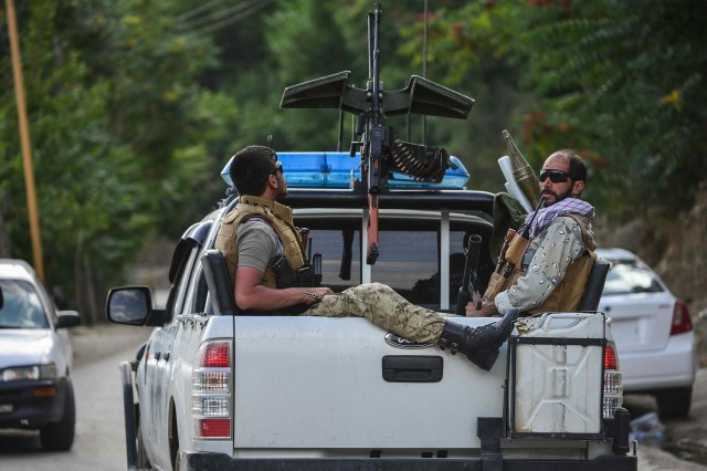 Afghan security forces personnel pictured traveling on a vehicle in Panjshir province on August 18, 2021.