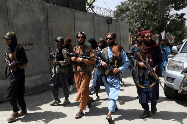 Taliban fighters patrol the Wazir Akbar Khan neighborhood of Kabul, Afghanistan, on Wednesday, August 18, 2021.
