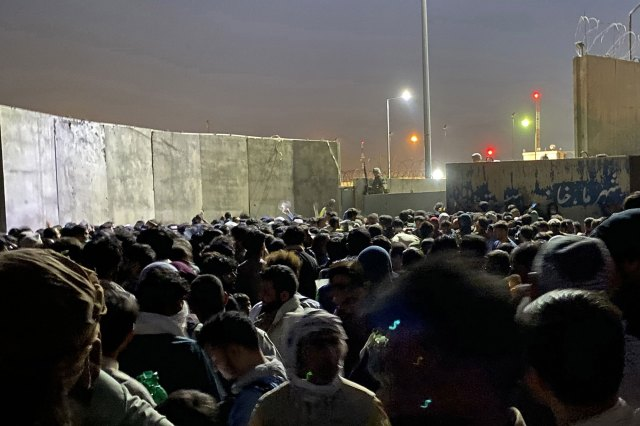 People struggle to get into the Hamid Karzai International Airport to flee the country in Kabul