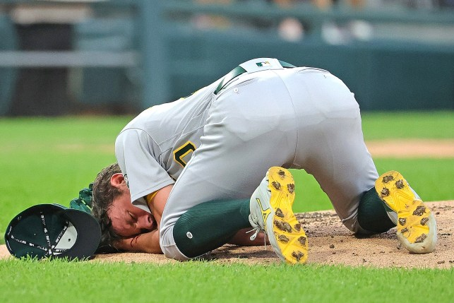 Chris Bast grabs his face after being hit by a line drive against the White Sox on August 17, 2021.