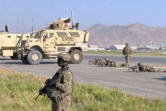 US troops stand guard at Kabul, Afghanistan Airport on August 16, 2021.