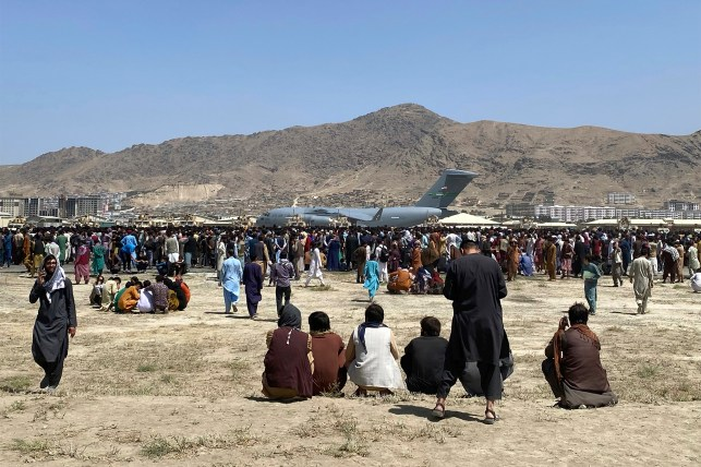 Seven people trying to flee Afghanistan have died after colliding with a US Air Force C-17 transport plane en route from Kabul.
