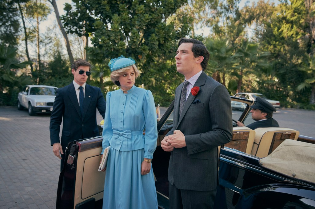 """Emma Corrin as Princess Diana, left, and Josh O'Connor as Prince Charles, right, lean against a car in """"The Crown."""""""