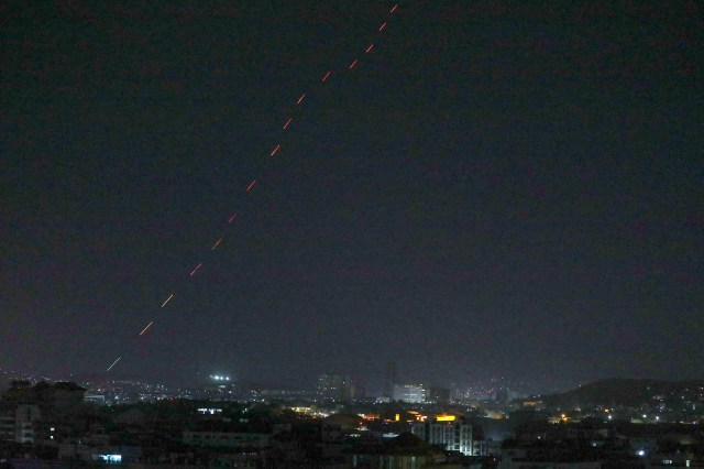 Celebratory gunfires light up part of the night sky after the last US aircraft took off from the airport in Kabul early on August 31, 2021.