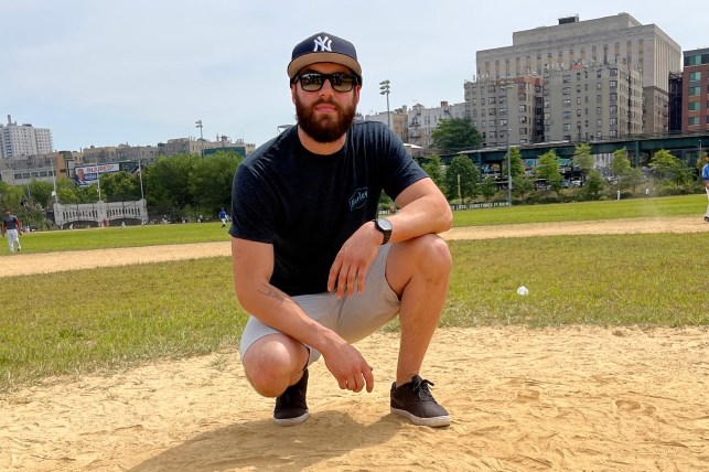 Justin Larson spreads Dawn's ashes on the site of the old Yankee Stadium.