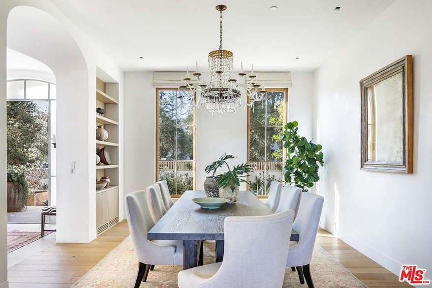 A formal dining room features inset shelving.