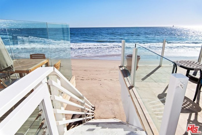 The home has an entrance to the beach.