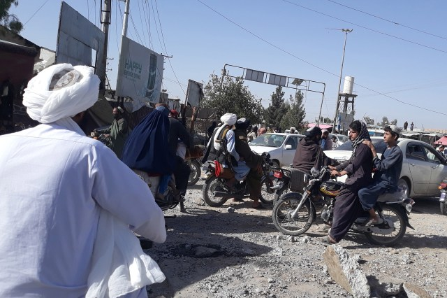 Taliban militants gather after taking control of Lashkar Gah, the provincial capital of Helmand, Afghanistan, on August 13, 2021.