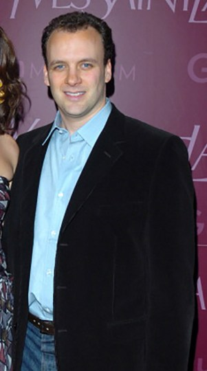 Mortimer Sackler in a jacket and shirt