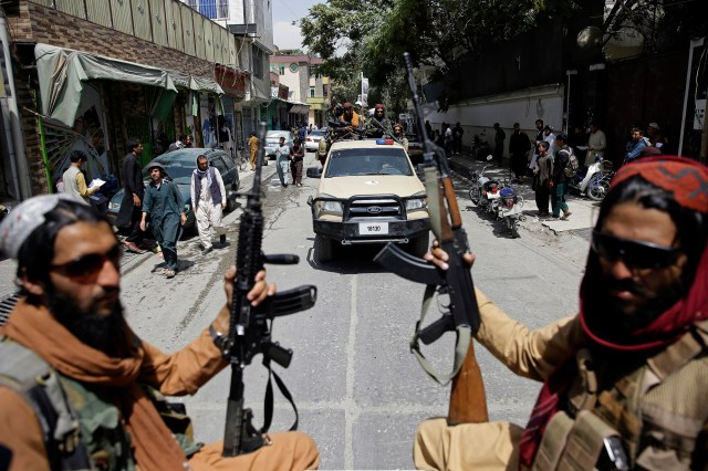 Armed Taliban fighters driving through Kabul on August 19, 2021.