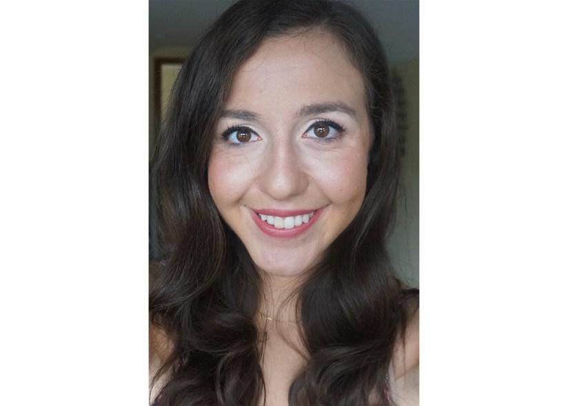 "Victoria Giardina wearing Too Faced's ""Hype Woman"" Em-Power Lipstick."