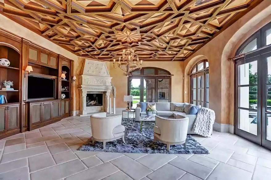 The family room is pictured from a different angle and reveals a fireplace.