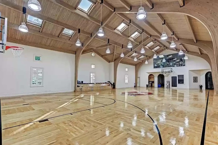 This full-size indoor basketball court has a cathedral ceiling.