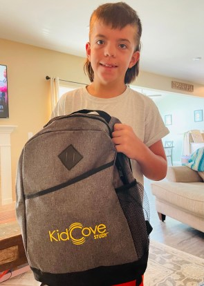 Walker with a backpack from the Moderna's KidCOVE study that he participated in.
