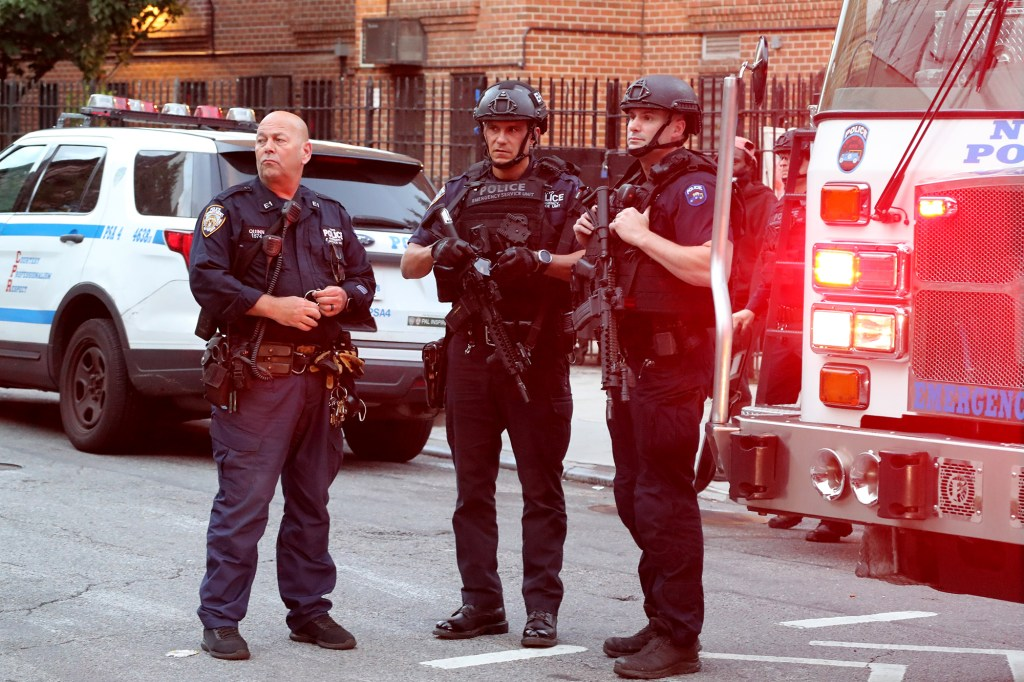 Police at the scene of a person shot at 213 Eldridge St in Manhattan.