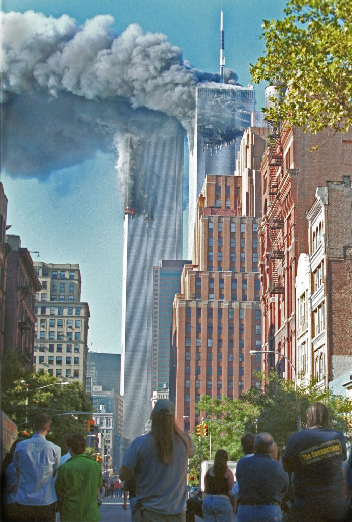 Horrified New Yorkers watched as the World Trade Center burned.