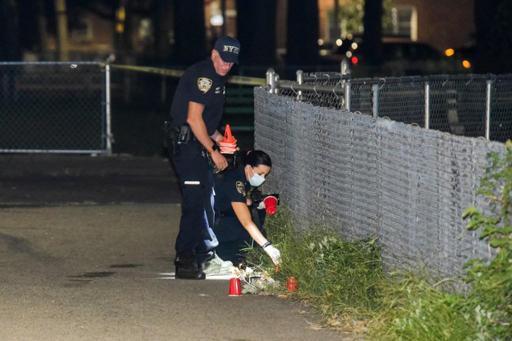 Cops mark bullets fired.