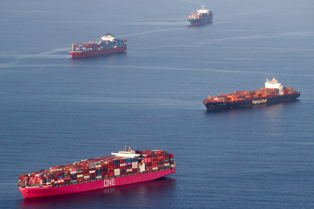 Container ships wait to dock and unload near Long Beach and Los Angeles, California.