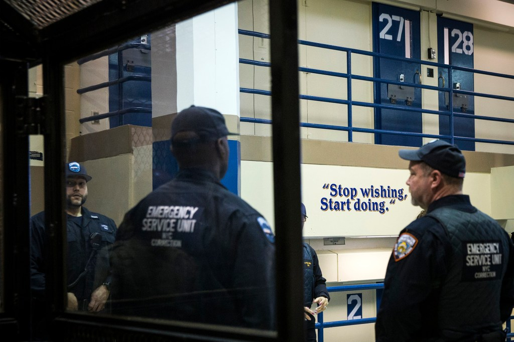 Corrections officers work in the Enhanced Supervision Housing Unit at the Rikers Island Correctional facility