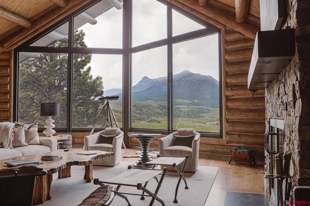 The two-story great room boasts mountain views.