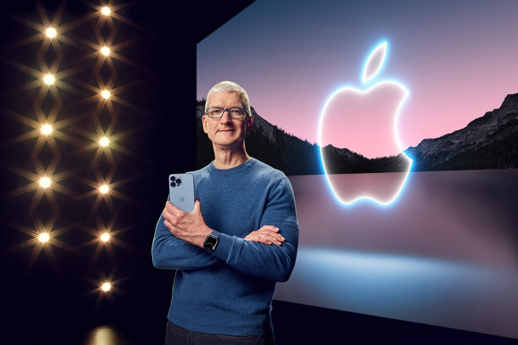 Tim Cook with new iPhone